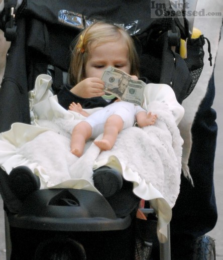 Violet Affleck plays with money