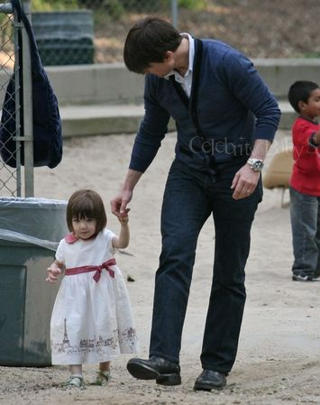 Suri and Tom Cruise at the park!